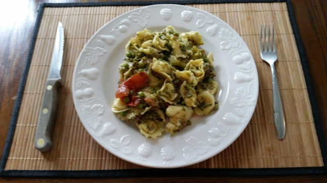 Pesto tortellini with porchetta