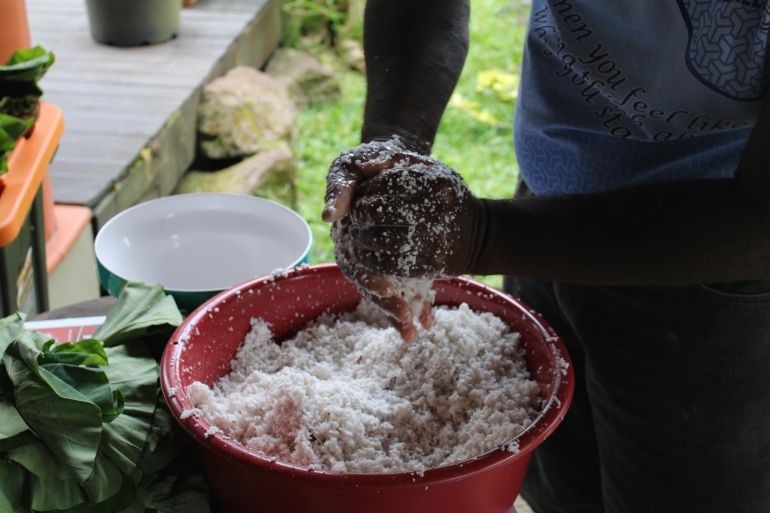 Squeezing milk from coconut shavings.