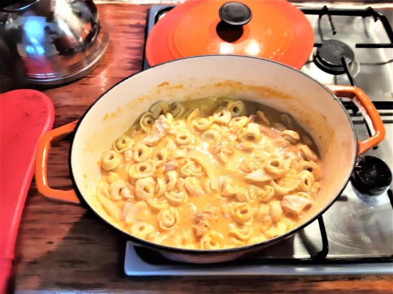 tortellini in coconut pumpkin sauce on stove top
